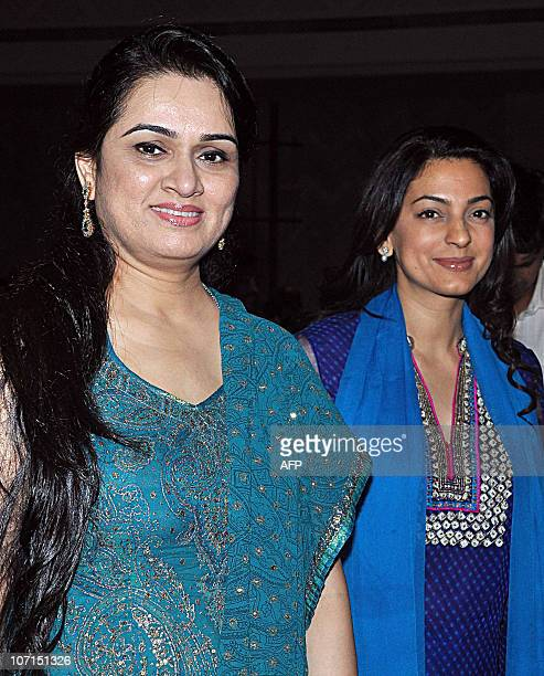 Indian Bollywood actress Padmini Kolhapure and Juhi Chawla arrive for the Divine Felicitations ceremony in Mumbai on November 25 2010 AFP PHOTO/STR