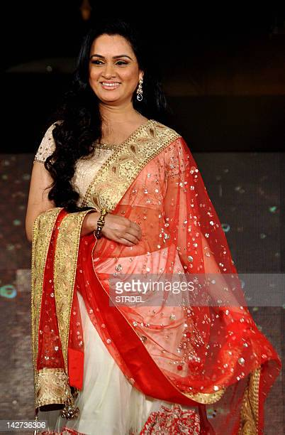 "Indian Bollywood actress Padmini Kolhapure displays a creation by designer Manish Malhotra for a public awareness campaign ""Save and Empower the Girl..."