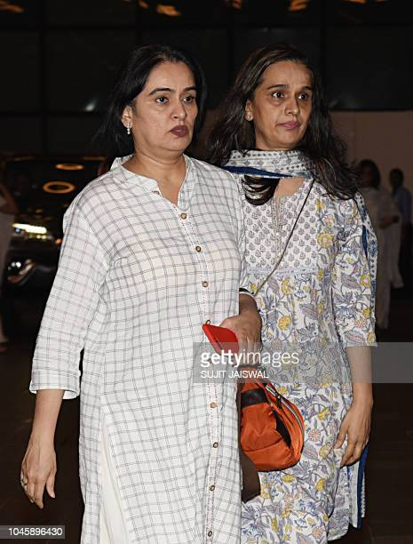 Indian Bollywood actress Padmini Kolhapure with her sister Shivangi Kapoor attend a prayer meet for the late Krishna Raj Kapoor wife of late actor...