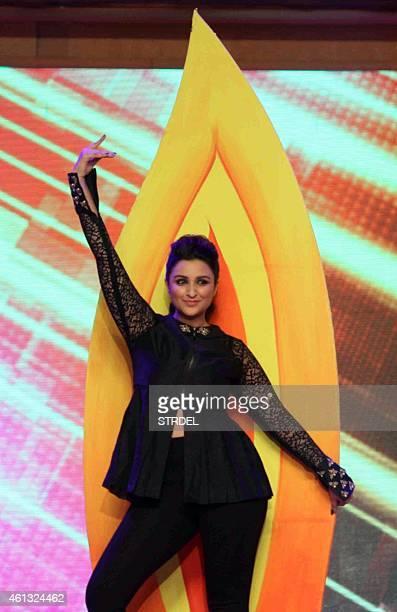Indian Bollywood actress Parineeti Chopra dances during the annual 'Umang 2015 Mumbai Police Show' in Mumbai on late January 10 2015 AFP PHOTO / STR