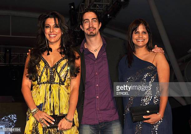 Indian Bollywood actress Pooja Bedi with brother Adam Bedi and Nisha Harale pose during the 'India Kids Fashion Week 2012' fashion show in Mumbai on...