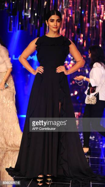 Indian Bollywood actress Pooja Hegde poses for a photograph during the grand finale of Lakme Fashion Week Winter/Festive 2017 in Mumbai on August 20...