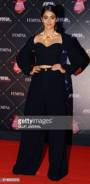 Indian Bollywood actress Pooja Hegde poses for a picture during the 'Femina Beauty Awards 2018' in Mumbai late on February 15 2018 / AFP PHOTO /...