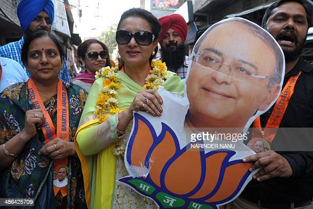 Indian Bollywood actress Poonam Dhillon and Bharatiya Janata Party supporters attend an election campaign event for BJP's Amritsar parliamentary seat...