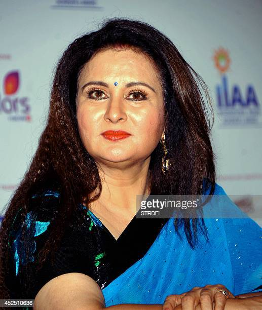 Indian Bollywood actress Poonam Dhillon looks on during the 2014 International Indian Achievers Awards trophy unveiling event in Mumbai on July 21...