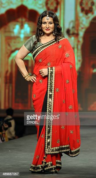 Indian Bollywood actress Poonam Dhillon models clothing during a cancer fundraiser in Mumbai on May 11 2014 AFP PHOTO/STR