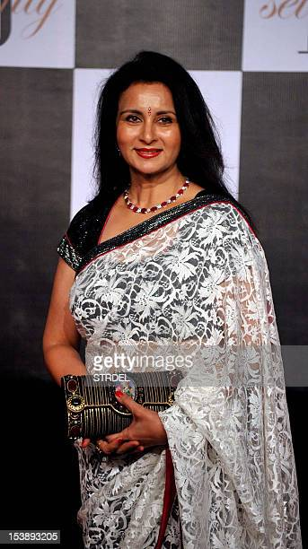 Indian Bollywood actress Poonam Dhillon poses as she arrives to attend the 70th Birthday celebration of Bollywood actor Amitabh Bachchan in Mumbai on...