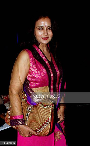 Indian Bollywood actress Poonam Dhillon poses as she attends a fashion show for The Mijwan Welfare Society in Mumbai late September 3 2012 AFP...