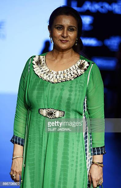 Indian Bollywood actress Poonam Dhillon poses as she attends Lakme Fashion Week Winter/Festive 2016 in Mumbai on August 26 2016 / AFP / Sujit JAISWAL