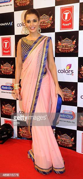 Indian Bollywood actress Poonam Dhillon poses during the 'Suron Ke Rang Color ke Sang Salaam Shri Gulshan Kumar' musical concert in fond memory of...