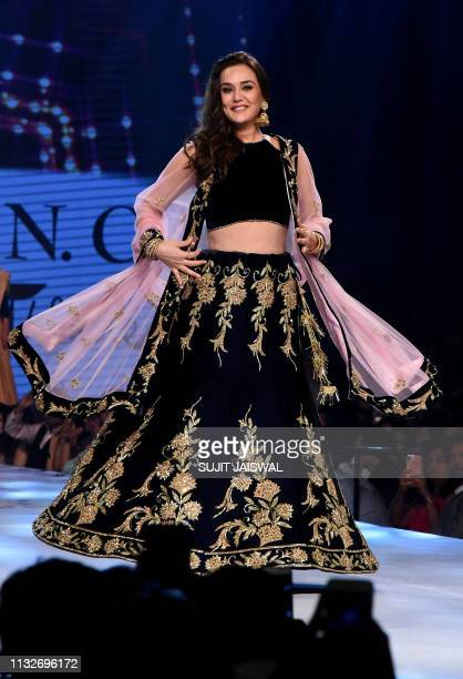 Indian Bollywood actress Preity Zinta displays a creation by designer Shaina NC during the 14th annual Caring with Style fashion show in association...