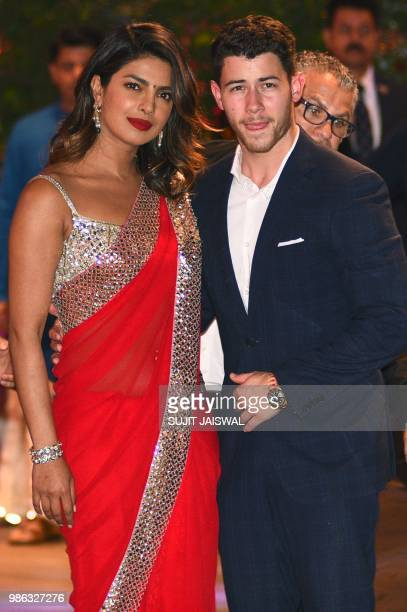 Indian Bollywood actress Priyanka Chopra accompanied by Nick Jonas arrive for the preengagement party of India's richest man and Reliance Industries...