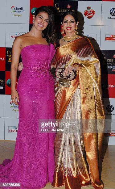 Indian Bollywood actress Priyanka Chopra and Sridevi attend the 'Zee Cine Awards 2018' ceremony in Mumbai on December 19 2017 / AFP PHOTO / Sujit...