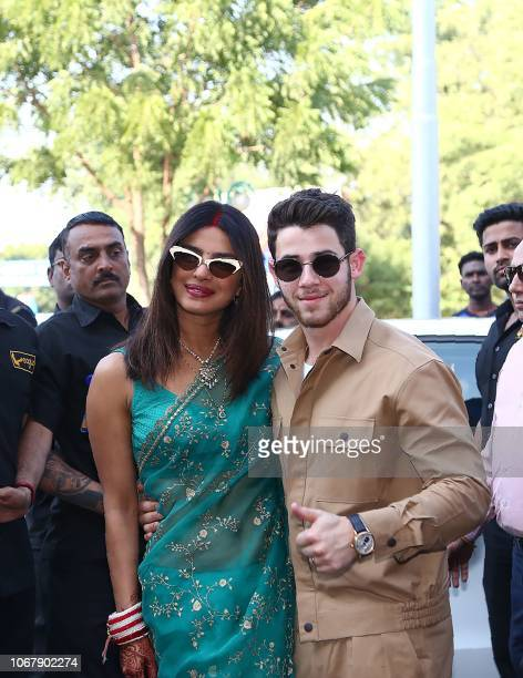 Indian Bollywood actress Priyanka Chopra and US musician Nick Jonas pose for a photograph as they leave after their wedding ceremony in Jodhpur in...