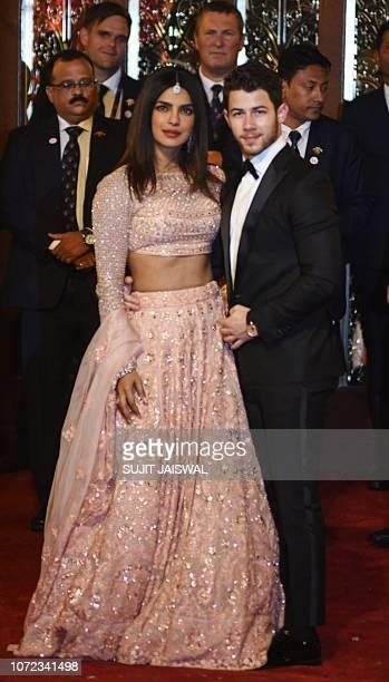 Indian Bollywood actress Priyanka Chopra and US musician Nick Jonas attend the wedding of Indian businesswoman Isha Ambani with Indian businessman...