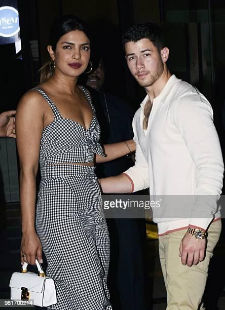 Indian Bollywood actress Priyanka Chopra and US singer Nick Jonas stand together in Mumbai on June 22 2018