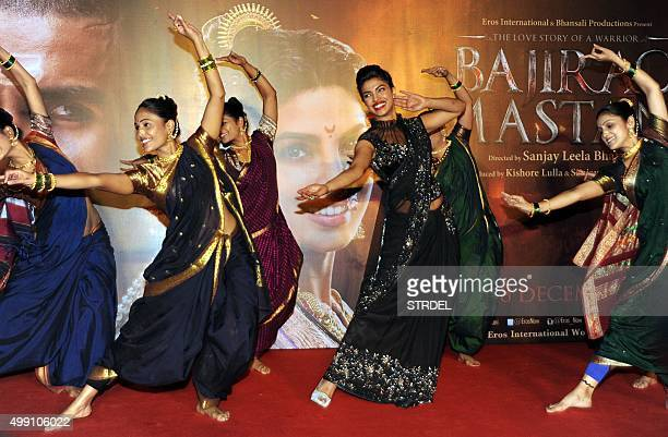 Indian Bollywood actress Priyanka Chopra dances during a promotional event for the forthcoming Hindi film 'Bajirao Mastani' directed by Sanjay Leela...