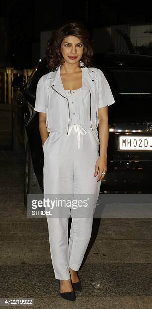 Indian Bollywood actress Priyanka Chopra poses as she attends a function in Mumbai late May 4 to celebrate actress Kangana Ranaut winning the...