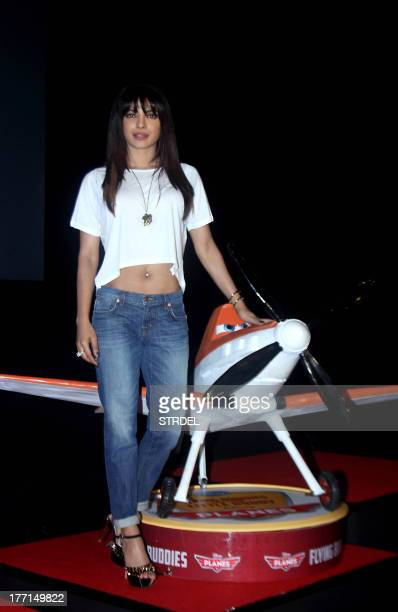 Indian Bollywood actress Priyanka Chopra poses during the launch of Disneys 'Planes' in Mumbai on August 21 2013 AFP PHOTO/STR