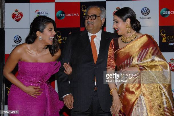 Indian Bollywood actress Priyanka Chopra producerdirector Boney Kapoor and Sridevi attend the 'Zee Cine Awards 2018' ceremony in Mumbai on December...