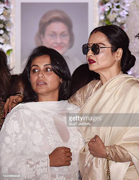 Indian Bollywood actress Rani Mukherjee and Rekha attend a prayer meet for the late Krishna Raj Kapoor wife of late actor Raj Kapoor in Mumbai on...