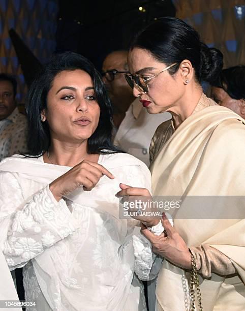 Indian Bollywood actress Rani Mukherjee and Rekha attend a prayer meet for the late Krishna Raj Kapoor wife of late actor Raj Kapoor in Mumbai on...