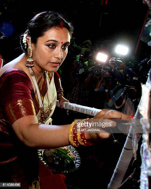 Indian Bollywood actress Rani Mukherjee poses during the 'sindoor' celebration of the North Bombay Sarbojanin Durga Puja in Mumbai on October 11 2016...