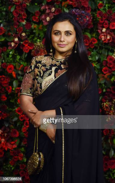Indian Bollywood actress Rani Mukherjee poses for a picture during the wedding reception party of actors Ranveer Singh and Deepika Padukone in Mumbai...