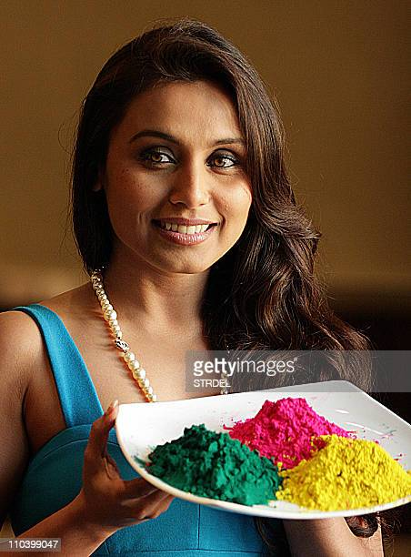 Indian Bollywood actress Rani Mukherjee poses with a tray of colours as she prepares to celebrate the Indian Festival of Holi at her residence in...