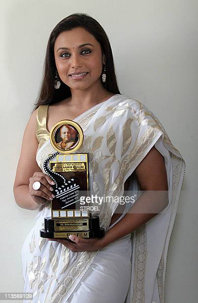 Indian Bollywood actress Rani Mukherjee poses with a trophy at the Dadasaheb Phalke Awards 2011 ceremony in Mumbai on May 3 2011 The Dadasaheb Phalke...