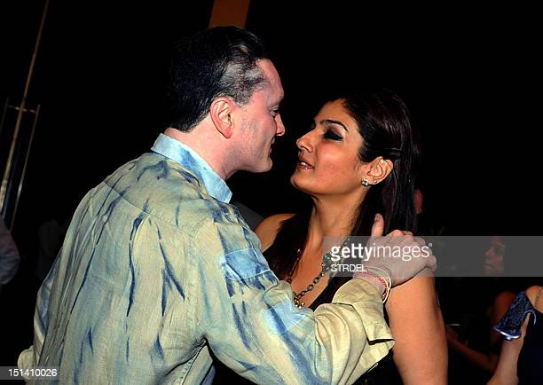 Indian Bollywood actress Raveena Tandon and Gautam Hari Singhania attend the launch of a jewellery line by Poonam Soni in Mumbai on September 6 2012...