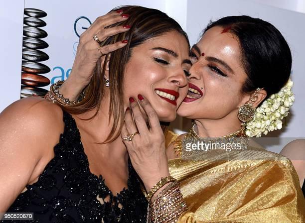 TOPSHOT Indian Bollywood actress Raveena Tandon and Rekha attend the GeoSpa asiaSpa India Awards 2018 in Mumbai on April 23 2018