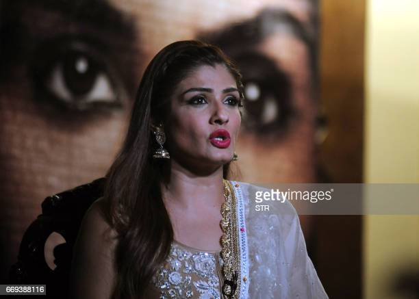 Indian Bollywood actress Raveena Tandon gestures as she addresses a press conference on her Hindi film Maatr in Mumbai on April 17 2017 / AFP PHOTO /...