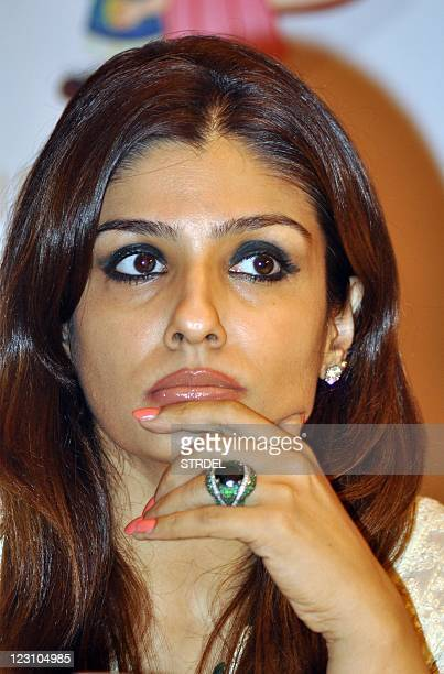 Indian Bollywood actress Raveena Tandon launches the Sanofi Pasteur India's 'Mother's Against Flu' social media community page in Mumbai on August 31...