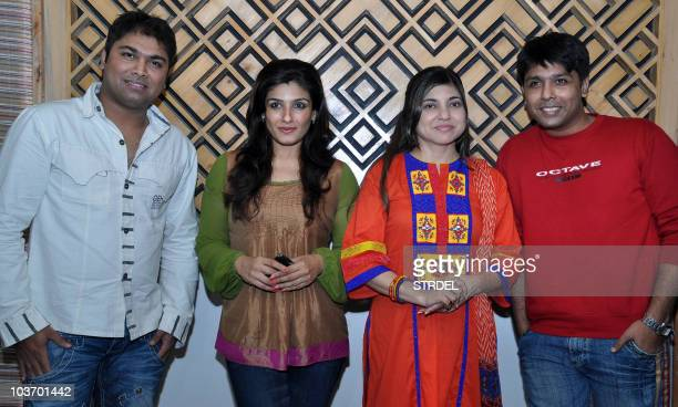 Indian Bollywood actress Raveena Tandon music director Darshan singer Alka Yagnik and actor Sanjeev attend the recording of a song for the...