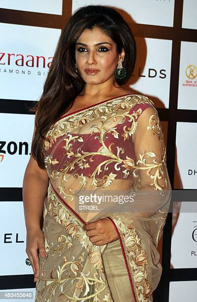 Indian Bollywood actress Raveena Tandon poses as she attends the eleventh Retail Jeweller India Awards 2015 in Mumbai late August 8 2015 AFP PHOTO/STR