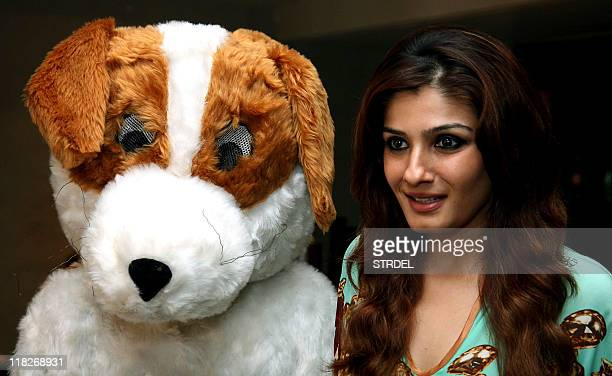 Indian Bollywood actress Raveena Tandon poses during a campaign for The People for the Ethical Treatment of Animals organisation in Mumbai on July 5...
