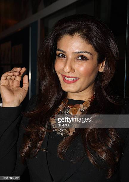Indian Bollywood actress Raveena Tandon poses for a photo during a showcase for the upcoming Lakme Fashion Week Spring Summer 2013 in Mumbai on March...