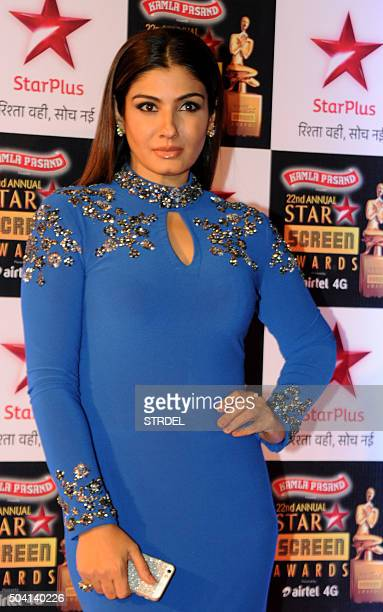Indian Bollywood actress Raveena Tandon poses for a photograph during the Star Screen Awards 2016 ceremony in Mumbai on late January 8 2016 AFP PHOTO...