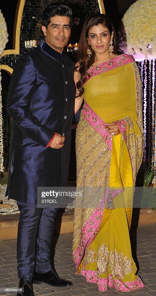 Indian Bollywood Actress Raveena Tandon Poses With Designer Manish Malhotra During The Wedding Reception Of