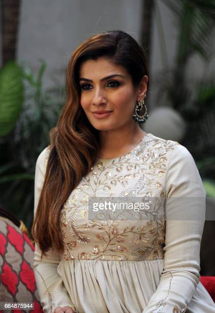 Indian Bollywood actress Raveena Tondon poses during the promotion of her upcoming revenge thriller film Maatr directed by Ashtar Sayed in Mumbai on...