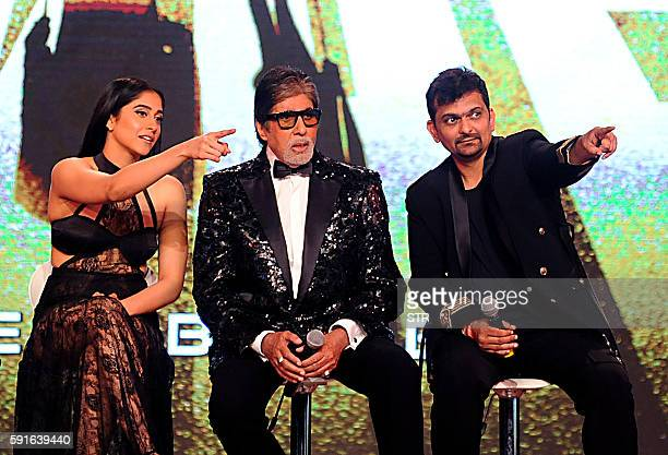 Indian Bollywood actress Regina Cassandra and Amitabh Bachchan and producer Gaurang Doshi interact during the announcement of the forthcoming Hindi...