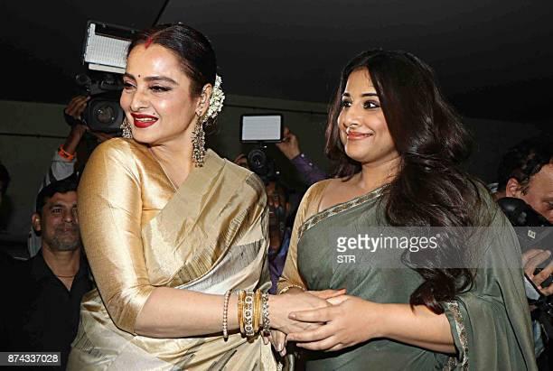 Indian Bollywood actress Rekha and Vidya Balan attend the special screening of the comedydrama Hindi film 'Tumhari Sulu' in Mumbai on November 14...