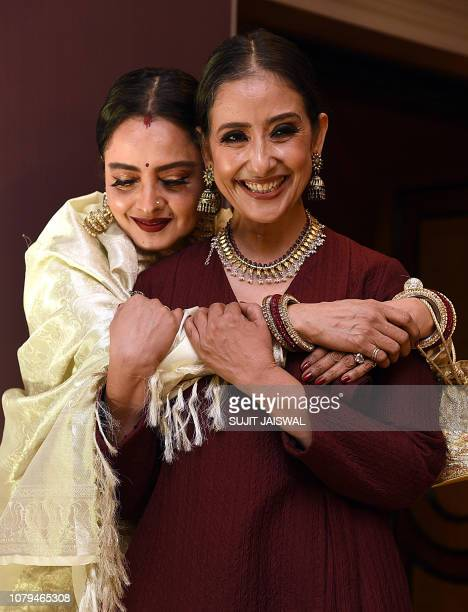 Indian Bollywood actress Rekha attends the book launch of Healed Bollywood actress Manisha Koirala's personal story of her battle against ovarian...