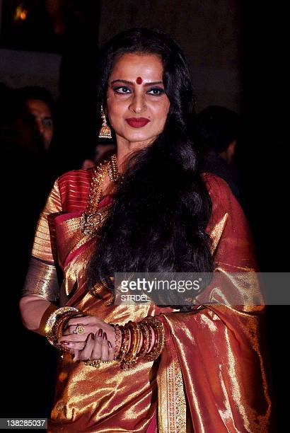 Indian Bollywood actress Rekha attends the wedding reception of actors Ritesh Deshmukh and Genelia D'Souza in Mumbai on February 4 2012 AFP PHOTO/STR