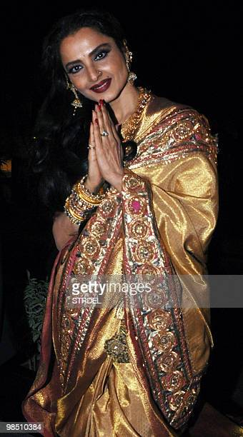 Indian Bollywood actress Rekha greets media representatives as she arrives to attend a celebrity laden function in Mumbai late April 16 2010 AFP...