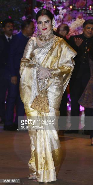 Indian Bollywood actress Rekha poses for a picture as she attends the preengagement party of India's richest man and Reliance Industries Limited...