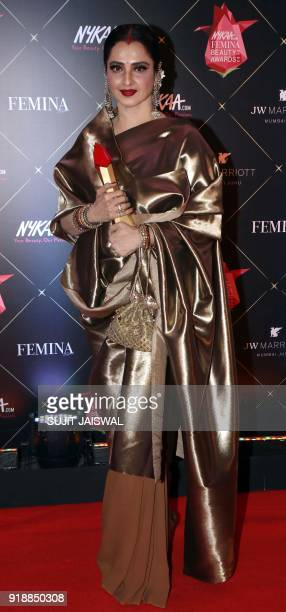 Indian Bollywood actress Rekha poses for a picture during the 'Femina Beauty Awards 2018' in Mumbai late on February 15 2018 / AFP PHOTO / Sujit...