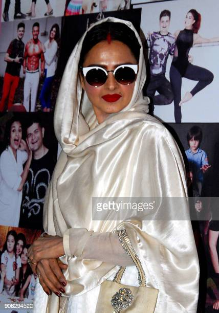 Indian Bollywood actress Rekha poses for a picture during the launch of photographer Dabboo Ratnanis 2018 Calendar in Mumbai late on January 17,...