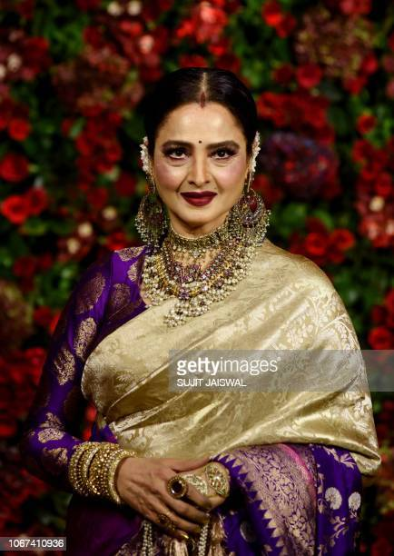 Indian Bollywood actress Rekha poses for a picture during the wedding reception party of actors Ranveer Singh and Deepika Padukone in Mumbai late on...